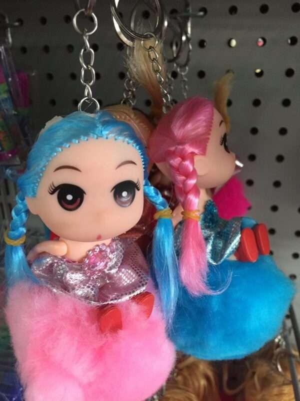 Doll with pom pom keychain